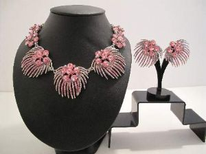 Late 1950's Pink firework necklace and earrings.